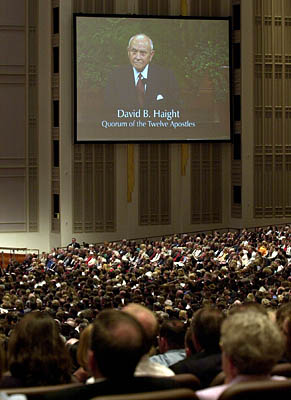 Haight's image is broadcast on a screen in the Conference Center during a 2001 General Conference talk.
