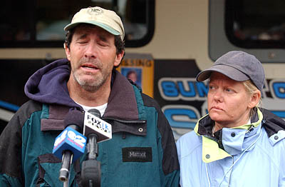 Kevin Bardsley, with his wife Heidi, gives an emotional statement to the press at the command center near Mirror Lake in the Uintah Mountains.