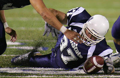 Utah State's John Chick grabs a 4th down fumble in the final 90 seconds of the 4th quarter, sealing Utah State's victory. Utah State vs. Idaho college football Saturday evening in Logan.