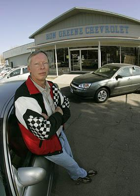 Ron Greene, owner of Ron Greene Chevrolet, poses outside his company on Thursday in Ephraim. The Bank of Ephraim's failure was