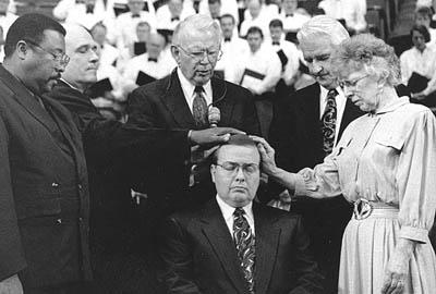 W. Grant McMurray is ordained in April 1996 as prophet-president of the Community of Christ, then known as the Reorganized Church of Jesus Christ of Latter Day Saints, at the faith's headquarters in Independence, Mo. This week, McMurray abruptly resigned as the church president and