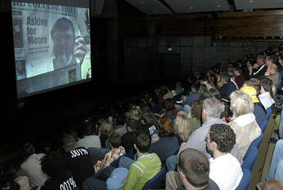 A crowd watches the premiere of Steven Greenstreet's film about Michael Moore's controversial appearance at UVSC