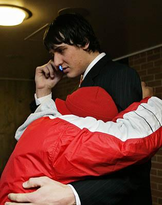 Andrew Bogut conducts a phone interview while hugging former teammate  Johnnie Bryant on Monday. a07b673c0