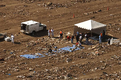 In this photo taken from a KUTV Channel 2 helicopter, the searchers sift through debris at the Salt Lake County Landfill, where Lori Hacking's remains were discovered.