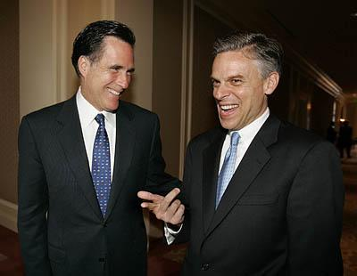 Massachusetts Gov. Mitt Romney, left, and Utah Gov. Jon Huntsman Jr. chat after a Republican Governors Association meeting Monday in Salt Lake City. Romney also gave a speech to Zions Bank clients.