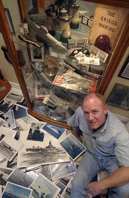Bob Schartmann, of Draper, right, has assembled hundreds of artifacts from many famous submarines in one of the largest private collections in the West. Over the past 30 years, Schartmann has had a