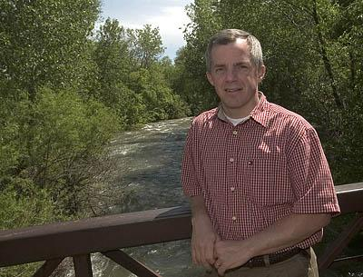 BYU engineer and profesor Jim Nelson has come up with a watershed model that predicts runoff and could change the way flood insurance is calculated.  Here he is along the very high Provo River during Spring runoff.