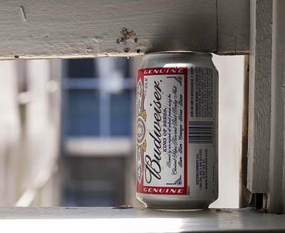 An empty beer can props open a window at Salt Lake City's Regis Hotel.