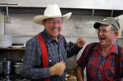 The jokes fly fast and furious at Frost's Cowboy Corral in Elsinore. Regular Walt LeFevre, left, shares a joke with Corral owner Jim Frost, who allows his customers to let themselves in before 6 a.m.