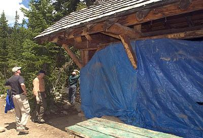 Lake Camp 2 three-sided Adirondack style shelter is covered with blue plastic.  The 50-year old structure was struck by lightning Tuesday night killing one scout and injuring three at Camp Steiner.