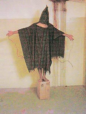 A hooded and wired Iraqi prisoner is seen at the Abu Ghraib prison near Baghdad, Iraq in this undated photo.
