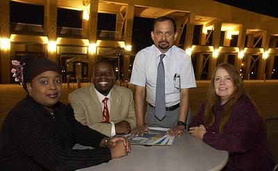 Ava Cabey-Norman, Abdul Malik Muhammad, Ghulam Hasnain and Katherine St.John at a planning meeting at Library Square for the Muslim Festival that will be held on August 28th at Library Square.