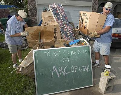 Joe Jacquez, left, and Joey Quintana of ARC of Utah pick up leftovers Wednesday from a yard sale in West Jordan. Curbside donations don't always make it to charities, however, as scavengers sometimes help themselves to such items.