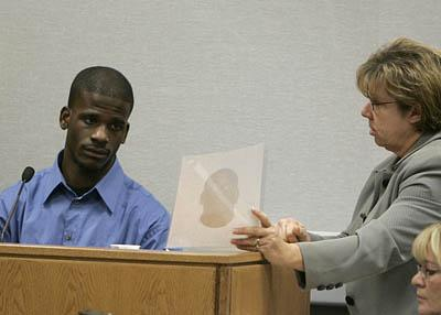 Witness Karland Bennett is shown a photo by prosecutor Donna Kelly during a trial for former BYU football players B.J. Mathis and Ibrahim Rashada.