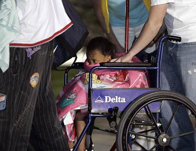 Evacuees from Hurricane Katrina exit a plane at the Utah Air National Guard. For some, it was their first trip to Utah.