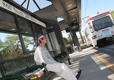 Downtown commuter Ricardo Rosas waits to board a TRAX at a new stop at 860 So. 200 W. Monday.
