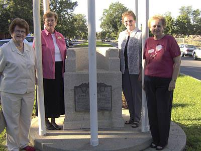 From left, Bette Barton, 1st Vice-President, International Society, Daughters of Utah Pioneers; Collette Lidell, Public Relations Chair for the Society; Frances Moore, Corresponding Secretary for the Society; abd Dawna Thayne, Marker Chair for the Society. The women are gathered around 1960's marker to the