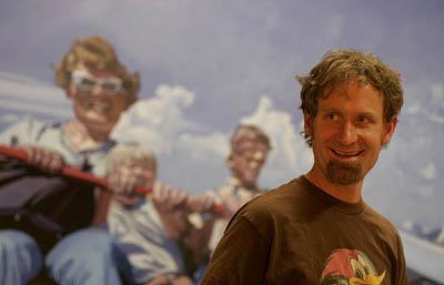 Brad Slaugh runs Poor Yorick Studios. He talks with admirers under his painting
