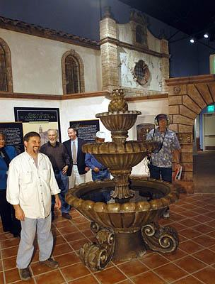 Rosario Provenza, left, exhibition designer of the El Camino Real International Heritage Center, leads a tour of the center earlier this month.