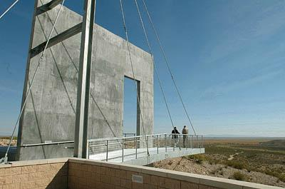 Tim McElroy, left, director of the El Camino Real International Heritage Museum, and Paul Harden, a member of the board, stand on a structure that gives the feel of a ship cutting through the desert at the El Camino Real International Heritage Museum near Soccorro, N.M., earlier this month.