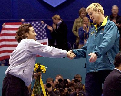 Steven Bradbury, right, is congratulated by Apolo Anton Ohno after Bradbury won gold in the 2002 Olympic 1,000 meters.
