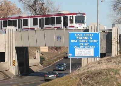 A TRAX train crosses the State Street TRAX bridge in Midvale.