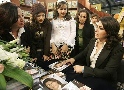Carmen Chammas talks to her fans during the launching of her astrology book in Beirut, Lebanon, earlier this month. Chammas will make a special New Year's Eve appearance to talk astrology.