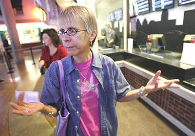 Carol Adams of Sandy expresses her frustration at the MegaPlex Theaters at Jordan Commons after showing up to see Friday's first screening of the movie ''Brokeback Mountain,'' only to find out it had been pulled from showing. Others were also disappointed.