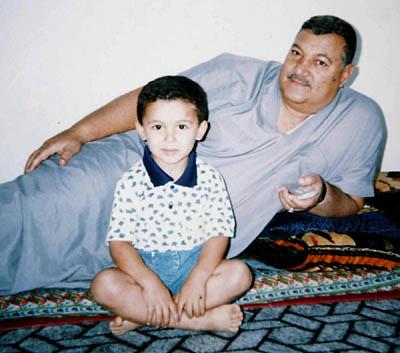 Former Iraqi Maj. Gen. Abed Hamed Mowhoush, with his grandson in an undated family photo, died in 2003 in U.S. custody in Iraq. A Utah guardsman has come forward with possible insight into Mowhoush's death.