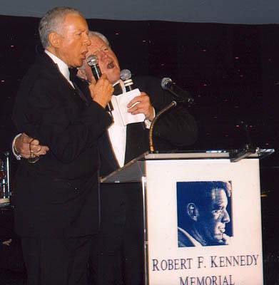 Massachusetts Sen. Ted Kennedy, D-Mass., right, and Utah Sen. Orrin Hatch, R-Utah, sing together at a fundraiser for the RFK Foundation.