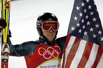 Ted Ligety holds the American flag after overcoming a 3-second deficit to win gold in the men's combined.