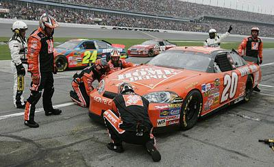 Tony Stewart's crew makes repairs to his car after he collided with Jeff Gordon on the 47th lap. Stewart finished fifth.