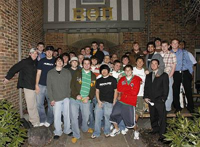Members of the U.'s Beta Theta Pi fraternity gather after a recent evening meeting at their house. This group, like other campus fraternities, has recorded a decline in membership.