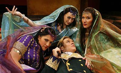 <br>Jessica Bowers, left, Heidi Stober and Jamie VanEych, playing the Three Ladies, seduce Tamino, played by Scott Murphree, in Utah Opera's production of