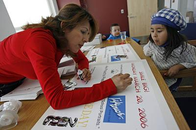 <br><br>Guadalupe Batalla, the first non-English-speaking PTA president in the state, works on a poster for Picture Day at Northwest Middle School alongside her daughter Belinda, 4. Batalla is among the Spanish-speaking parents trying to be more involved in the PTA.