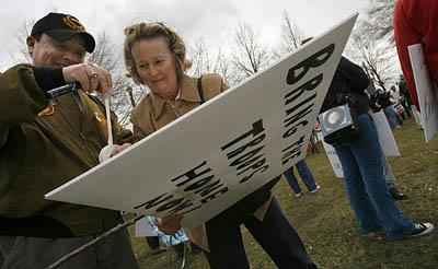 Luciano Martinez and his wife, Peggy, of Murray, attend an anti-war rally Saturday in Salt Lake City.