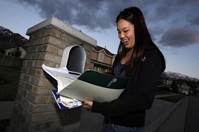 Katherine Bark, a senior at West High School, checks her mailbox at the end of the day for acceptance and rejection letters from out-of-state colleges.