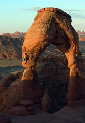This image, provided by Dean Potter, shows Potter climbing Delicate Arch inside Arches National Park in Utah on Sunday. The park rushed Tuesday to tighten its rules on climbing after Potter announced, with photographs and video to back him up, that he made the unassisted climb.