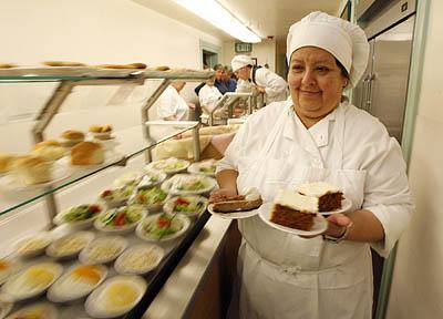 Rosa Santeliz keeps the Lion House Pantry's cafeteria-style line stocked with sweets, salads and the famous Lion House dinner rolls.