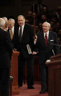 <br><br>Gordon B. Hinckley greets fellow general authorities of the LDS Church on Saturday as he enters the Conference Center in Salt Lake City.