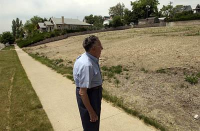 Above, Glen Spencer stands at the former location of the LDS wardhouse in the Avenues, at the corner of K Street and 9th Avenue, which was demolished in 2004.
