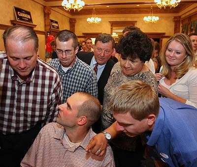 US Congressman Chris Cannon (center background) leans in with supporters to get a closer look at the early results coming in at the HIstoric County Courthouse in Provo June 27, 2206 during primary election for the 3rd congressional district.