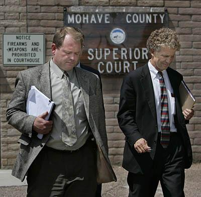 After his conviction, Kelly Fischer, left, of Colorado City, Ariz., leaves the courthouse in Kingman with his attorney, Bruce Griffen.  A Mohave County jury found Fischer, 39, had engaged in sex with a 16-year-old girl he took as a plural wife about six years ago and that it occurred in the home they shared in Colorado City.