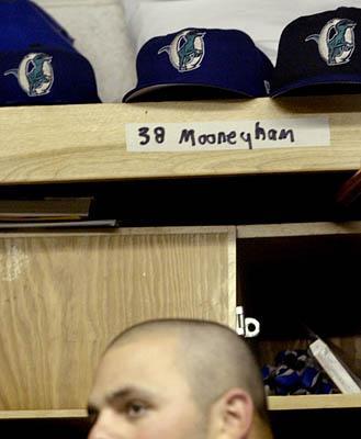 Ogden Raptor Jason Mooneyham gets ready in the locker room before the game against the Casper Rockies.
