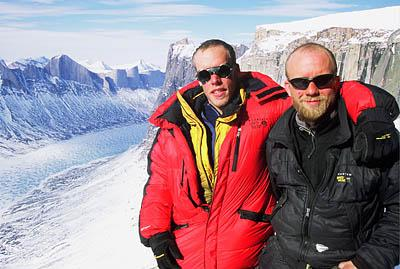 Kyle Dempster, left, and Drew Wilson share a moment after reaching the summit of a never-before-climbed cliff on Baffin Island.