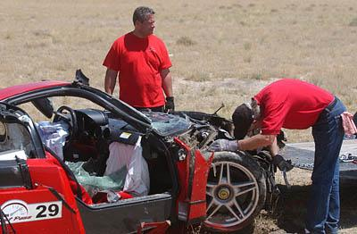 A crew collects the wreckage of a $1.3 million 2003 Ferrari Enzo that crashed during the Utah Fast Pass Road Rally . Driver Richard Losee suffered fractured bones.