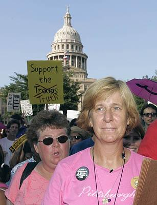 Anti-war activist Cindy Sheehan, foreground, leads a march from the Texas Capitol Wednesday, Aug. 31, 2005, in Austin, Texas. Her protest outside President Bush's ranch ended, she begins a three-week bus tour of the country.