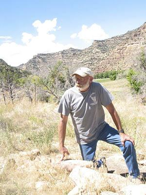 Duncan Metcalf, the lead archaeologist in Range Creek Canyon, looks over the ruins of a Fremont Indian pit house.