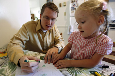 Ben Christensen draws with daughter Sophie, 3, in the family kitchen. Despite being gay and a Mormon, Ben Christensen of Orem is trying to make his life work with wife Jessie and his two kids Sophie and Timothy, 2 months.