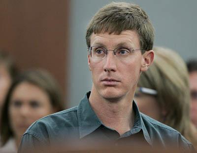 Nephi Jeffs stands in an apparent display of respect Thursday as his brother Warren Jeffs, leader of the Fundamentalist Church of Jesus Christ of Latter Day Saints, leaves the Nevada courtroom. Nephi was misidentified as another brother, Isaac Jeffs.